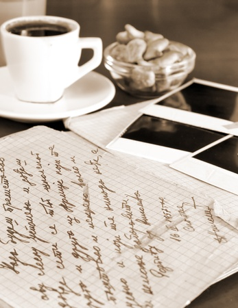 old letters and pictures with morning coffee,sepia added photo