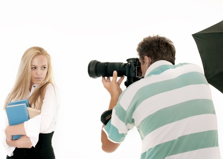 Photographer Taking Pictures of a Model in the Studio. It is not isolated Imagens