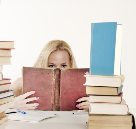 shyness: Girl hiding behind the book, staring at you