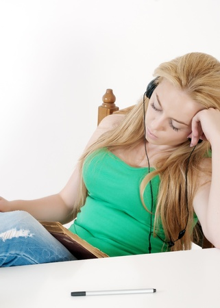 beautiful girl listening to music and learn.Back to school. Stock Photo - 10464954
