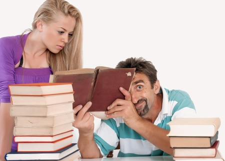 Mad teacher holding book and making faces photo