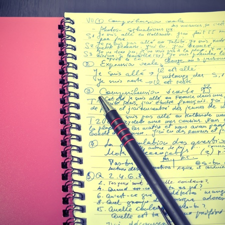 open notebook and pen on the table photo