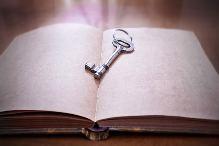 magic book: Old key on a open book