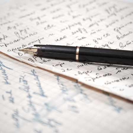 prose: Old letter and fountain pen.Close up photo.