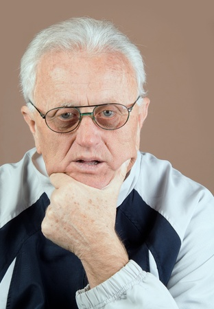 75s: Close up photo of 75-s year old senior man looking at camera. It is not isolated.