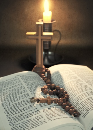 close up vintage photo of rosary on bible  photo