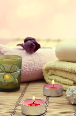 relaxant: Wellness and spa concept with candles, collection of towels and flower