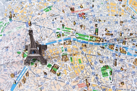 historical landmark: Eiffel tower on a map of Paris Stock Photo