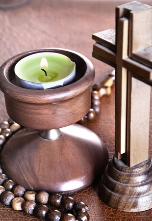 Crucifix with Lit Tea Candles on Bible,close up photo Stock Photo - 11514696