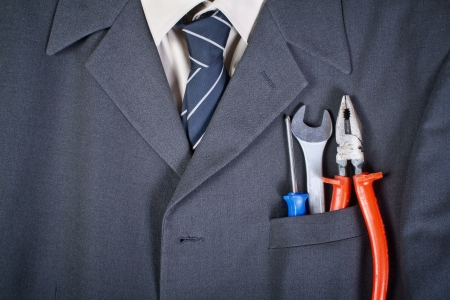 Close up photo of tools  in the businessman pocket