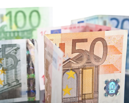 euromoney: different euro banknotes over white background