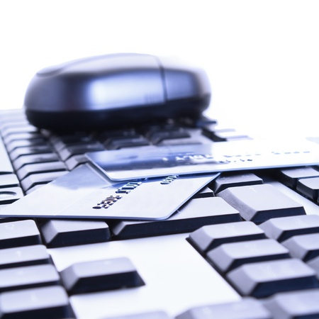 On the keyboard of a computer is a credit card. Online banking and shopping Stock Photo