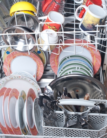 dirty dishes in the dishwasher Stock Photo