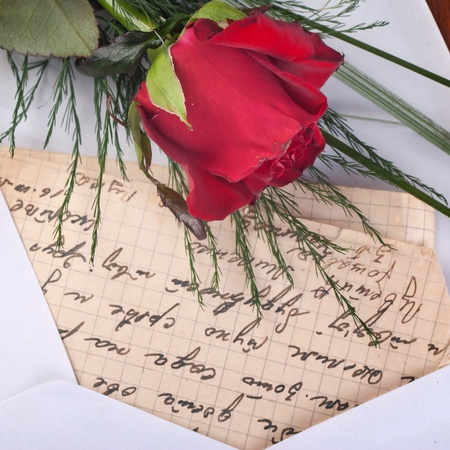 Red Rose and Letter on wooden background photo
