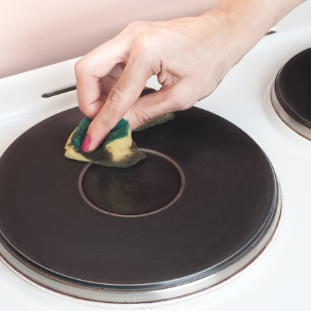 cleaning old electric stove,close up Stock Photo - 11960802