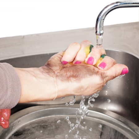 washing of dirty sponges in dirty hand Stock Photo - 11960800