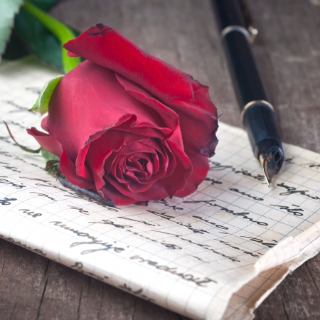 poem: Love letter and rose close up