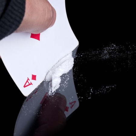cocaine or other drugs cut with playing card on mirror. Stock Photo - 12227710