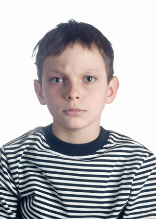 Close-up portrait of angry  boy over white background Stock Photo