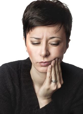 close-up foto van mooie vrouw met kiespijn Stockfoto