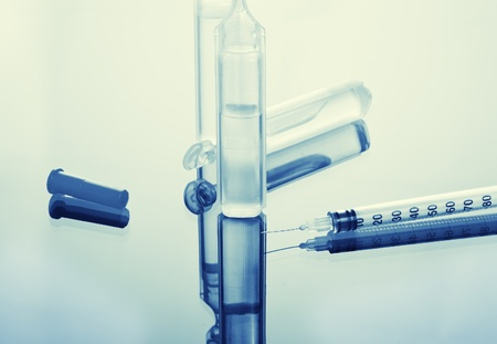 close up of medical ampoules and syringe Stock Photo - 12766595
