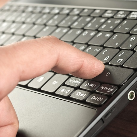 close up of finger on the keyboard photo