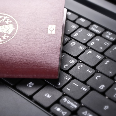close up photo of  passport on the keyboard Stock Photo