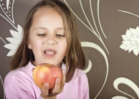 bad apple: girl with bad teeth and apple Stock Photo