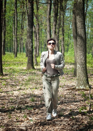 Female runner running in forest photo