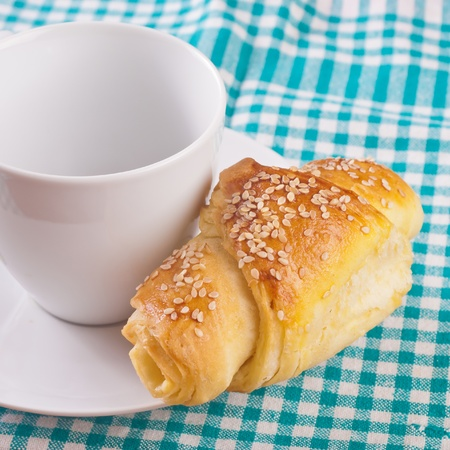 buttery: close up of empty coffee cup and croissants