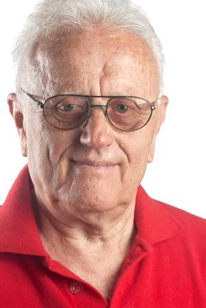 75s: Studio portrait of smiling senior man wearing glasses. Stock Photo