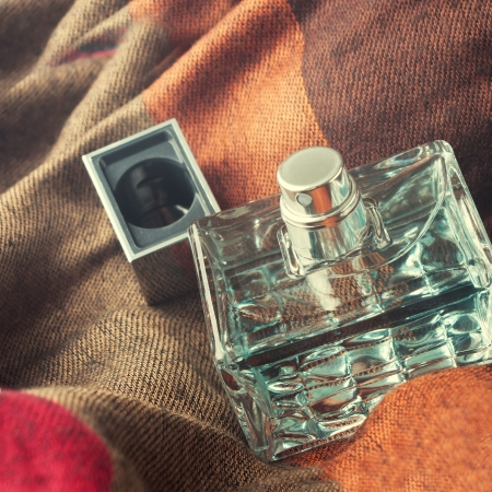 perfume bottle on a fabric  background