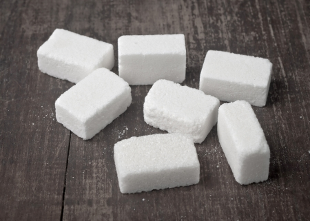 sugar: sugar Cubes on wooden table