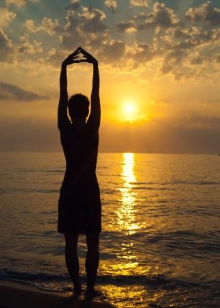 Sunset, sexy woman silhouette photo