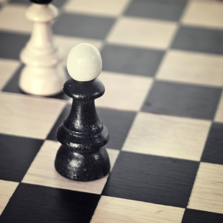 competitor: chess bishop on board,close up