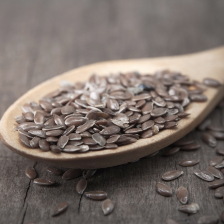 wooden spoon with brown flax seeds on it Stock Photo - 15409556