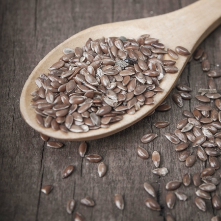 wooden spoon with brown flax seeds on it Stock Photo - 15409558