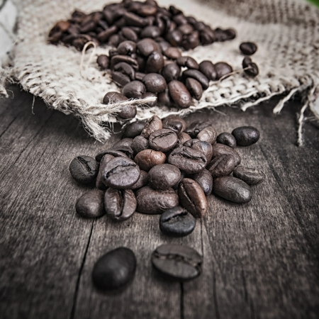 Group of coffee beans on top of burlap  photo