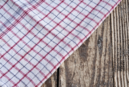 White and red striped dish cloth on brown wood Stock Photo - 15747876