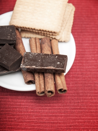 Cinnamon Sticks with chocolate on table Stock Photo - 15992088