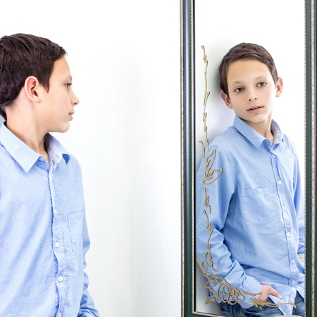 boy posing in front of mirror