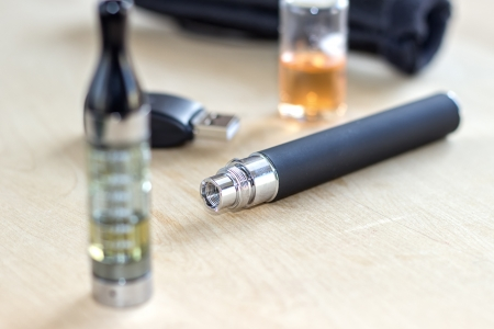 Black electronic nicotine inhalator on table