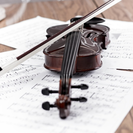 Violin with bow and music sheet photo