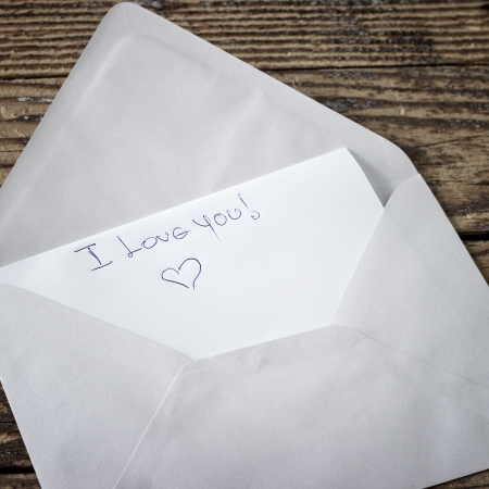 unsealed envelope on the table,I love you Stock Photo - 18051054