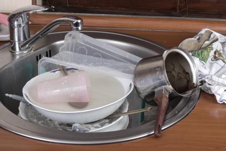 appalling: huge heap of dirty dishes waiting for the flatmate Stock Photo