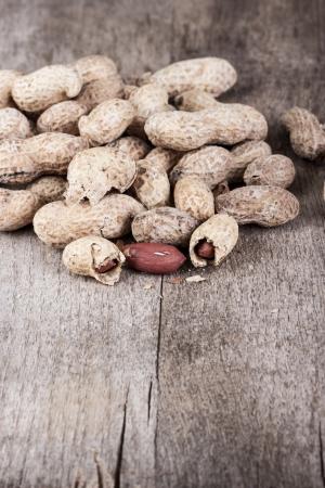 goober peas: Fresh Roasted Peanuts on wooden table