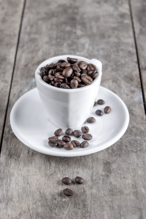 caffiene: Coffee beans in espresso cup