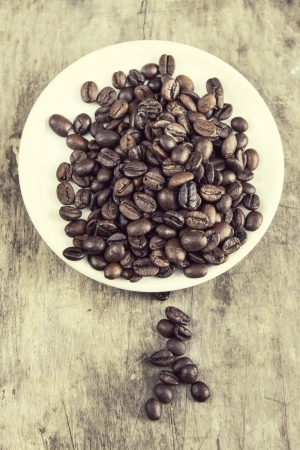 caffiene: Coffee beans on table ,retro style Stock Photo