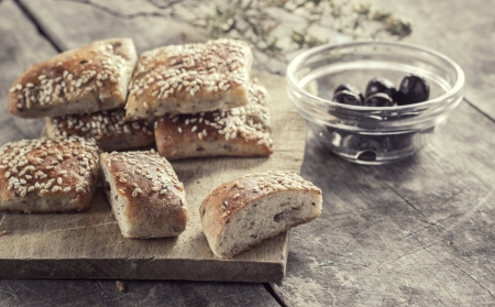 homemade  scones with olives on the table photo