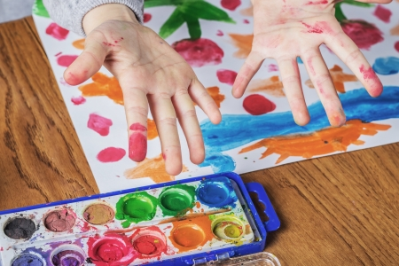 Child hands painting, close up photo photo